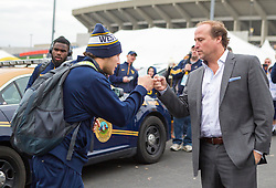 Nov 7, 2015; Morgantown, WV, USA; West Virginia Mountaineers quarterback Skyler Howard (left) fist bumps West Virginia Mountaineers head coach Dana Holgorsen as they arrive to the stadium to play the Texas Tech Red Raiders at Milan Puskar Stadium. Mandatory Credit: Ben Queen-USA TODAY Sports