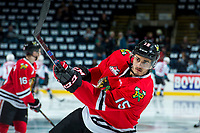 KELOWNA, CANADA - APRIL 8: Shaun Dosanjh #15 of the Portland Winterhawks warms up with a shot on net against the Kelowna Rockets on April 8, 2017 at Prospera Place in Kelowna, British Columbia, Canada.  (Photo by Marissa Baecker/Shoot the Breeze)  *** Local Caption ***