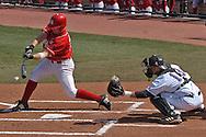 Nebraska's Nick Sullivan hits the ball up the middle in the first inning against Kansas State.  Nebraska held on to beat Kansas State 5-4 at Tointon Stadium in Manhattan, Kansas, April 1, 2006.