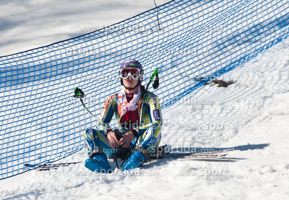 22.01.2011, Tofana, Cortina d Ampezzo, ITA, FIS World Cup Ski Alpin, Lady, Cortina, Abfahrt, im Bild nach ihrem Ausfall sitz Tina Maze (SLO, #14) enttäuscht am Pistenrand // disappointed Tina Maze (SLO) during FIS Ski Worldcup ladies Downhill at pista Tofana in Cortina d Ampezzo, Italy on 22/1/2011. EXPA Pictures © 2011, PhotoCredit: EXPA/ J. Groder