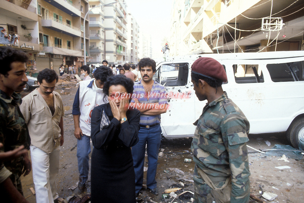 A woman reacts amid the aftermath of a car bomb explosion in the Fakhani neighborhood of West Beirut, Lebanon. The bomb, killing 86 and wounding 225, was placed outside the offices of the PLO.