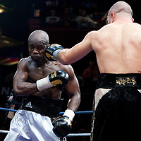 19 November 2009: Fight between Blanchard Kalambay (white trunks) and Zakaria Azzouzi (black trunks) during the Grand Tournoi boxing semi finals event at Cirque d'Hiver in Paris, France.