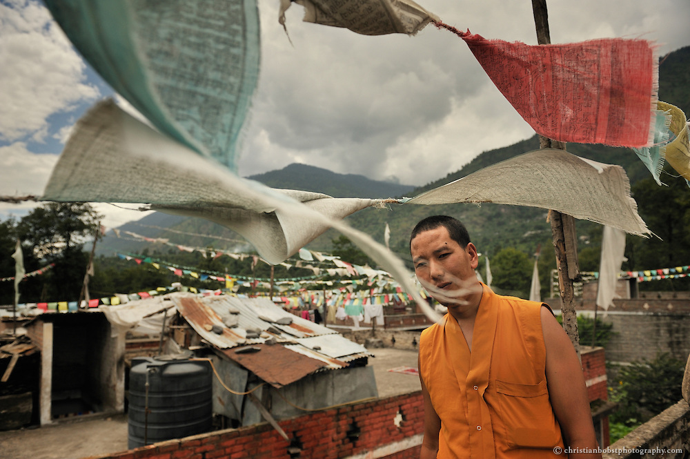 Portrait of a monk on the roof of a Tibetan refugee camp in Manali, India, 2009