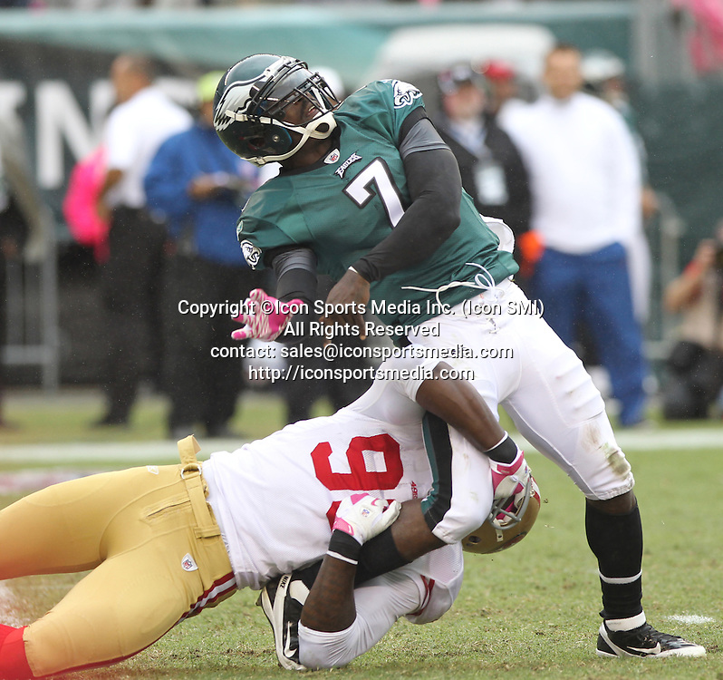 Oct. 2, 2011 - Philadelphia, PA, USA - Michael Vick, left, of the Eagles tries to throw the ball away while Justin Smith of the 49ers holds on in the 2nd quarter. The San Francisco 49ers defeated the Philadelphia Eagles, 24-23, at Lincoln Financial Field in Philadelphia, Pennsylvania, Sunday, October 2, 2011