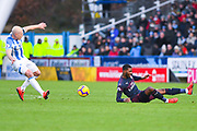 Aaron Mooy of Huddersfield Town (10) and Ainsley Maitland-Niles of Arsenal (15) battle for the ball during the Premier League match between Huddersfield Town and Arsenal at the John Smiths Stadium, Huddersfield, England on 9 February 2019.