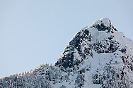 Fresh snow on the rock and trees Alouette Mountain's Blanshard Peak in the Mount Blanshard massif.  Photographed from along Gold Creek at Golden Ears Provincial Park in Maple Ridge, British Columbia, Canada