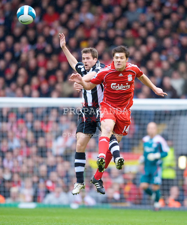 LIVERPOOL, ENGLAND - Saturday, March 8, 2008: Liverpool's Xabi Alonso and Newcastle United's Michael Owen during the Premiership match at Anfield. (Photo by David Rawcliffe/Propaganda)