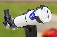 New Paltz, New York - A refractor telescope with a solar filter is set up on the State University of New Paltz campus to watch the Transit of Venus on June 5, 2012. Venus crossed in front of the sun and was visible as a small black disk. The next Venus transit will not occur until 2117.