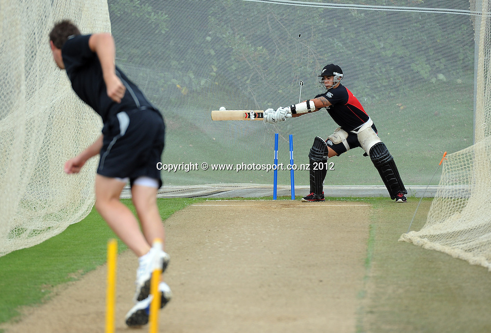 Tim Southee bowls to Shaun Johnson as the Vodafone Warriors joined the New Zealand Black Caps for a training session at Colin Maiden Oval, Auckland on Tuesday 21 February 2012. Photo: Andrew Cornaga/Photosport.co.nz