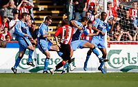 Photo: Richard Lane/Richard Lane Photography. Wycombe Wanderers v Brentford. Coca Cola Fotball League Two. Brentford's Glenn Poole fires in a shot.