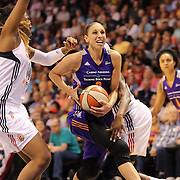 Diana Taurasi, (centre), Phoenix Mercury, drives to the basket defended by Chiney Ogwumike, (right) and Kelsey Bone, Connecticut Sun, during the Connecticut Sun Vs Phoenix Mercury WNBA regular season game at Mohegan Sun Arena, Uncasville, Connecticut, USA. 12th June 2014. Photo Tim Clayton