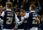 Millwall team mates celebrate Millwall FC Midfielder Shane Ferguson's goal during the Sky Bet League 1 match between Millwall and Colchester United at The Den, London, England on 21 November 2015. Photo by Andy Walter.