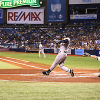 New York Yankees shortstop Derek Jeter (2) gets a hit during a major league baseball game between the New York Yankees and the Tampa Bay Rays at Tropicana Field on Thursday, Sept. 17, 2014 in St. Petersburg, Florida. (AP Photo/Alex Menendez)