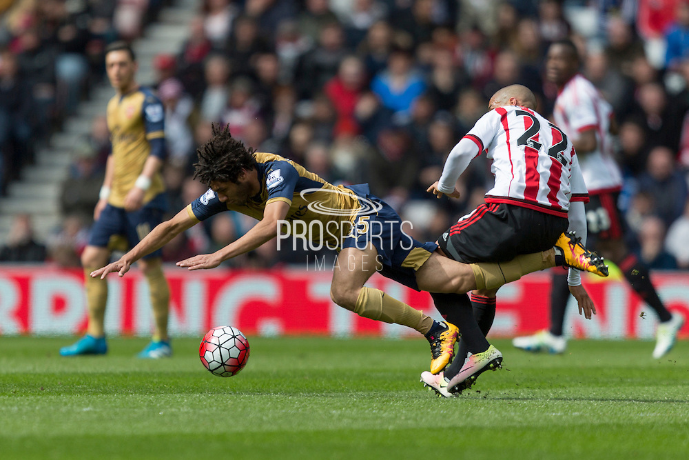 Arsenal midfielder Mohamed Elneny (35) is tackled by Sunderland's Midfielder Wahbi Khazri (22) during the Barclays Premier League match between Sunderland and Arsenal at the Stadium Of Light, Sunderland, England on 24 April 2016. Photo by George Ledger.