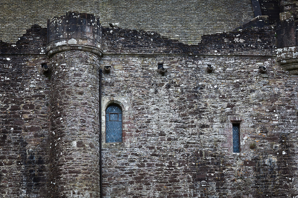 """A """"typical"""" castle wall with turret. I only say typical because castles are pretty abundant in the UK. But was is unique is each stone and how they are fit and placed on top of each other."""