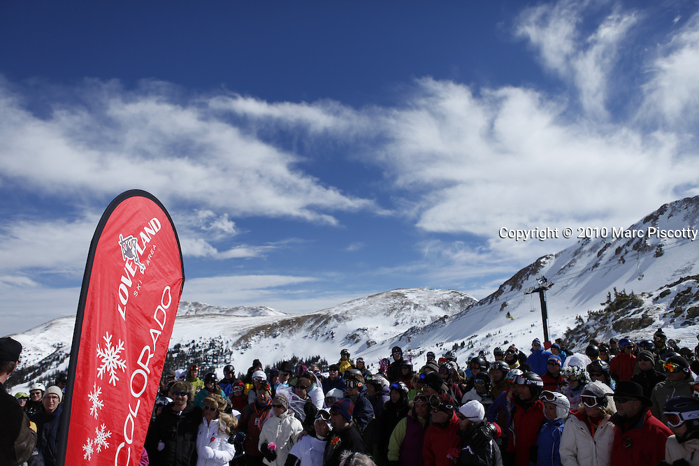 SHOT 2/14/11 1:13:21 PM - Loveland Ski Area in Colorado hosted the 20th Annual Marry Me & Ski Free Mountaintop Matrimony on Valentine's Day Monday, February 14th. The mass wedding ceremony was held at noon at 12,050 feet outside of the Ptarmigan Roost Cabin at Loveland. More than 75 couples were pre-registered to get married or renew their vows high on The Continental Divide in this yearly Loveland tradition.  Following the ceremony couples were invited to a casual reception complete with a champagne toast, wedding cake and music.  (Photo by Marc Piscotty / © 2010)