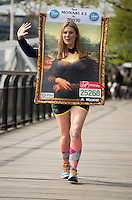Virgin Money London Marathon 2015<br /> <br /> Guinness World Record attempt!<br /> Gemma Kirkham from Bedford UK attempting to break the World record for running a Marathon dressed as a painting.<br /> <br /> Photo: Bob Martin for Virgin Money London Marathon<br /> <br /> This photograph is supplied free to use by London Marathon/Virgin Money.