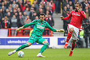 Kelle Roos of Derby County is pressured by Lewis Grabban of Nottingham Forest during the EFL Sky Bet Championship match between Nottingham Forest and Derby County at the City Ground, Nottingham, England on 9 November 2019.