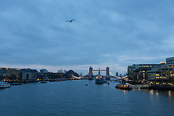 "© Licensed to London News Pictures. 18/01/2016. London, UK. Cloudy blue grey sky behind Tower Bridge in London at sunrise this morning. Today, known as ""Blue Monday"" is meant to be the most depressing day of the year. Photo credit : Vickie Flores/LNP"