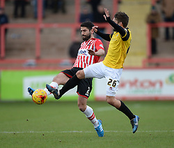 Exeter City's Danny Butterfield battles for the ball with Northampton's Ricky Holmes - Photo mandatory by-line: Alex James/JMP - Mobile: 07966 386802 - 10/01/2015 - SPORT - football - Exeter - St James Park - Exeter City v Northampton - Sky Bet League Two