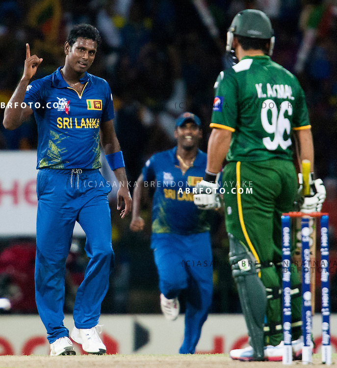Sri Lankan Angelo Mathews lifts his finger after getting Kamran Akmal out during the World T20 Cricket Mens Semi Final match between Sri Lanka Vs Pakistan at the R Premadasa International Cricket Stadium, Colombo. Photo credit : Asanka Brendon Ratnayake