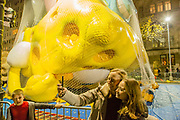 New York, NY – 27 November 2019. Thousands of spectators packed the streets around the American Museum of Natural History to see the inflation area for the balloons for Macy's Thanksgiving Day Parade. Two women pose for selfies with Spongebob Squarepants and Gary in the background.