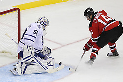 Nov 2; Newark, NJ, USA; Toronto Maple Leafs goalie Jonas Gustavsson (50) makes a save on New Jersey Devils center Adam Henrique (14) during the first period at the Prudential Center.