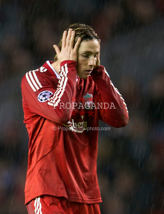 LIVERPOOL, ENGLAND - Wednesday, December 9, 2009: Liverpool's Fernando Torres looks dejected as his side lose 2-1 to AFC Fiorentina during the UEFA Champions League Group E match at Anfield. (Photo by David Rawcliffe/Propaganda)