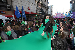 June 14, 2018 - Congreso, Argentina - A woman walks on a green banner. After a marathon debate, Argentina's Congress approved a bill to legalize abortion. The bill passed by a razor-thin margin, with 129 lawmakers voting to legalize elective abortion up to 14 weeks of pregnancy, while 125 voted against and one abstained. (Credit Image: © Claudio Santisteban via ZUMA Wire)