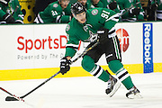 DALLAS, TX - OCTOBER 17:  Tyler Seguin #91 of the Dallas Stars looks for the puck against the San Jose Sharks on October 17, 2013 at the American Airlines Center in Dallas, Texas.  (Photo by Cooper Neill/Getty Images) *** Local Caption *** Tyler Seguin