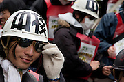 A student activist with Zengakren (All Japan Federation of Students' Autonomous Body) wearing a helmet and sunglasses at a demo march outside Hosei university, Ichigaya, Tokyo, Japan Friday April 23rd 2010