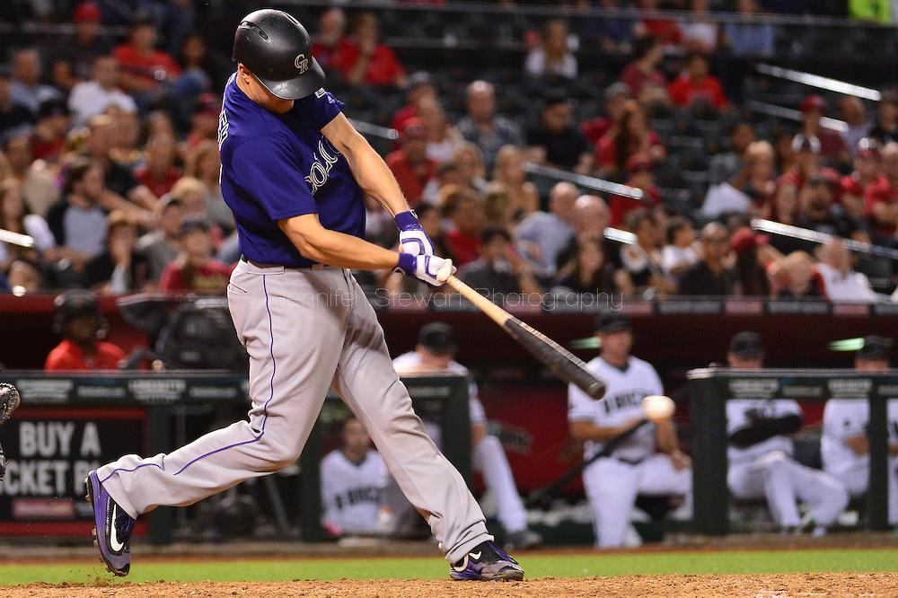 Apr 29, 2016; Phoenix, AZ, USA; Colorado Rockies catcher Nick Hundley (4) doubles to left driving in two runs during the eighth inning against the Arizona Diamondbacks at Chase Field. Mandatory Credit: Jennifer Stewart-USA TODAY Sports