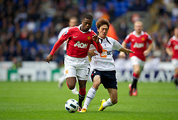 BOLTON, ENGLAND - Sunday, September 26, 2010: Manchester United's Patrice Evra and Bolton Wanderers' Chung-yong Lee during the Premiership match at the Reebok Stadium. (Photo by David Rawcliffe/Propaganda)
