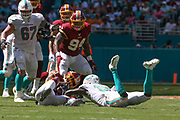 Sunday, October 13, 2019; Miami Gardens, FL USA;  Washington Redskins cornerback Quinton Dunbar (23) intercepts a pass intended for Miami Dolphins wide receiver Preston Williams (18) during an NFL game at Hard Rock Stadium. The Redskins beat the Dolphins 17-16. (Kim Hukari/Image of Sport)
