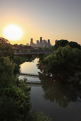 Sunrise over the Rosemont Bridge and Buffalo Bayou with Houston, Texas skyline.