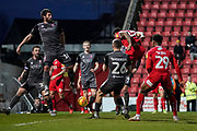 Kaiyne Woolery of Swindon Town heads the down towards goal during the EFL Sky Bet League 2 match between Swindon Town and Lincoln City at the County Ground, Swindon, England on 12 January 2019.