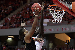 "20 March 2017:   Daouda ""David"" Ndiaye (4) gets a hand between the basket and the shot by B.J. Taylor during a College NIT (National Invitational Tournament) 2nd round mens basketball game between the UCF (University of Central Florida) Knights and Illinois State Redbirds in  Redbird Arena, Normal IL"