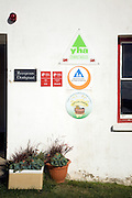 Signs outside youth hostel, St David's, Pembrokeshire, Wales