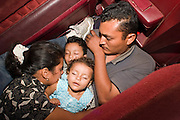 05 MAY 2003 - SELLS, ARIZONA, USA: A family of undocumented immigrants from the Mexican state of Jalisco hide in the back of pickup truck after the driver of the truck was stopped by a Tohono O'Odham tribal police officer for speeding on AZ 86 east of Sells, AZ, the capital of Tohono OOdham Indian Reservation, May 5, 2003. The Tohono OOdham reservation covers a vast expanse of Southern Arizona and has a 70 mile border with Mexico. In recent years the reservation has been flooded with undocumented immigrants who pass through the reservation on their way north to Phoenix, AZ, and other cities in the US. About 1,500 undocumented immigrants, most from Mexico, cross the reservation, which has more land than the state of Delaware,  every day. According to the tribal government, the tribal police department spends about 60 percent of its resources dealing with crime created by the undocumented immigrants. Many times tribal police officers have to wait hours for the US Border Patrol to respond to calls to pick up undocumented immigrants. This family was released by the tribal police two hours after the Border Patrol was notified that the police had the family. The Border Patrol didn?t respond the tribal police call. PHOTO BY JACK KURTZ