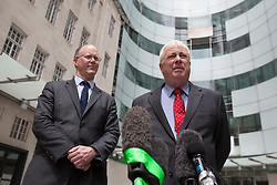 © licensed to London News Pictures. London, UK 04/07/2012.  George Entwistle, the new director of the BBC (left) and BBC Trust Chairman Lord Patten (right) speaking to TV crews today, outside BBC's New Broadcasting House. BBC Trust Chairman Lord Patten has appointed George Entwistle as the Director-General of the BBC. Photo credit: Tolga Akmen/LNP
