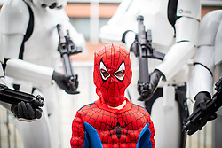 © Licensed to London News Pictures . 30/07/2017 . Manchester , UK . Spiderman (Joseph Hughes, five from Heaton Mersey) , surrounded by Storm Troopers . Cosplayers, families and guests at Comic Con at the Manchester Central Convention Centre . Photo credit : Joel Goodman/LNP