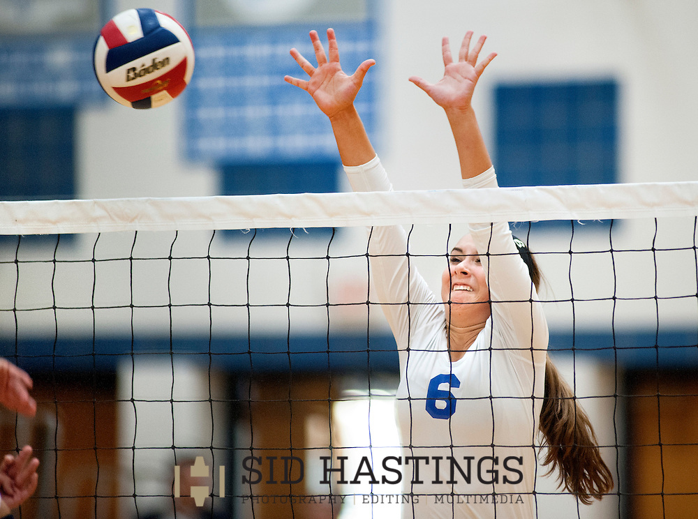 25 AUG. 2015 -- ST. CHARLES, Mo. --Duchesne High School volleyball player Molly Sifford (6) returns a shot  against St. Pius X High School at Duchesne in St. Charles, Mo. Tuesday, Aug. 25, 2015. St. Pius won, 2-0 (25-14, 25-23), to advance to 6-0. It was Duchesne's first match, dropping them to 0-1 on the year. Photo © copyright Sid Hastings.