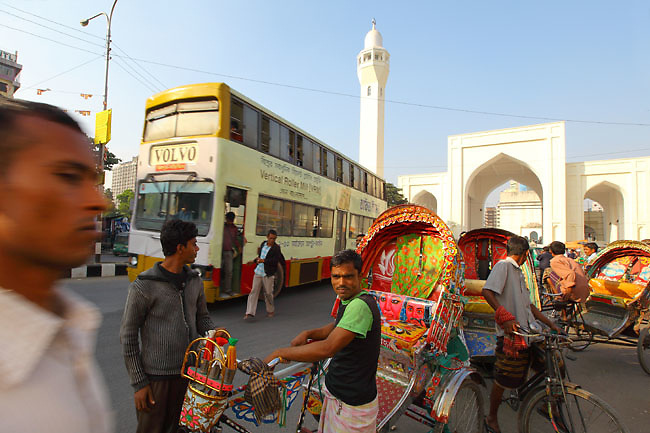 Rickshaw drivers waiting for customers in the streets of Old Dhaka (Dhaka, Bangladesh).