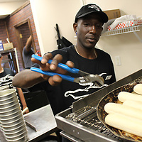 RAY VAN DUSEN/BUY AT PHOTOS.MONROECOUNTYJOURNAL.COM<br /> Godfather's Pizza employee Joe Robinson goes to pull out a pan of breadsticks during a training session at the franchise's Amory location, which opens this week at Heritage Inn and Suites.