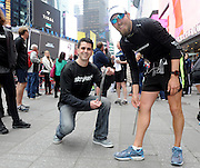 Ultra marathon runner Daren Wendell and Frank Mastrangelo, of Stryker Orthopaedics, display the Stryker T2 Tibia Nail that is in Wendell's right leg, Friday, April 10, 2015, in New York, after Wendell concluded his cross country journey,  Wendell ran 2,903 miles in100 consecutive days with the titanium rod in his right leg, which was surgically implanted following a severe soccer injury and experienced no leg pain along his journey. He ran across the country to raise money for Activewater, an organization that provides safe drinking water to African communities.(Photo by Diane Bondareff/Invsion for Stryker/AP Images)