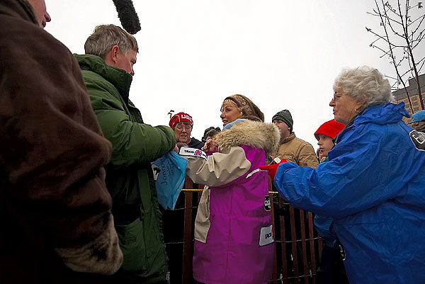 04 March 2006: Anchorage, Alaska - Fan favorite and cancer survivor, DeeDee Jonrowe of Willow, AK talks to reporters as she signs autographs before the Ceremonial Start in downtown Anchorage of the 2006 Iditarod Sled Dog Race.