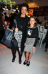 LULU GUINNESS and her daughter MADELAINE at a party to celebrate the launch of DKNY Kids and Halloween in aid of CLIC Sargent and RX Art held at DKNY, 27 Old Bond Street, London on 31st October 2006.<br /><br />NON EXCLUSIVE - WORLD RIGHTS