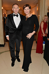 KATE SILVERTON and her husband MIKE HERON at the Tusk Friends Dinner in aid of wildlife charity Tusk held at Claridge's, Brook Street, London on 11th March 2014.