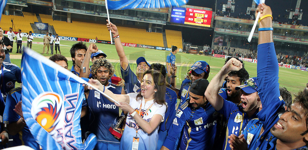 Nita Ambani waves the flag high during the Final of the NOKIA Champions League T20 ( CLT20 ) between The Royal Challengers Bangalore and The Mumbai Indians held at the M. A. Chidambaram Stadium in Chennai , Tamil Nadu, India on the 9th October 2011..Photo by Ron Gaunt/BCCI/SPORTZPICS