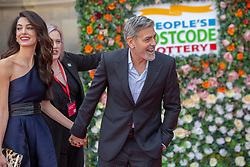 George and Amal Clooney arrive at the People's Postcode